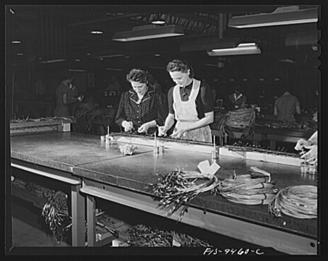 De Soto bomber plant, Detroit, Michigan. Putting eyelet contacts on ends of wires