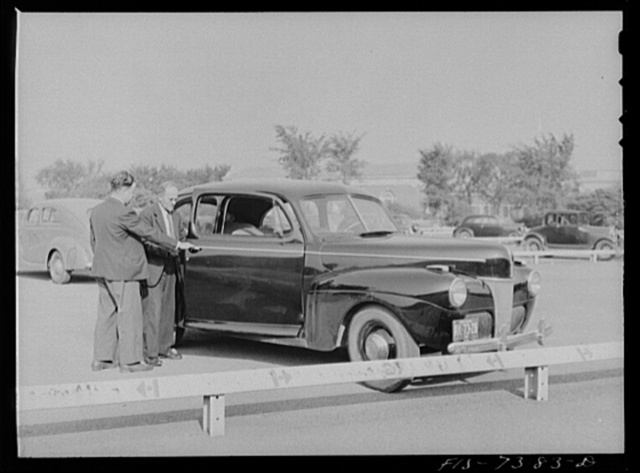 Dearborn, Michigan. Karl Axel Westerberg and his son, Eric, leaving the plant of the Ford Motor Company where his son is employed as an expert tool and die maker and he is foreman of the rough stock department of the Johansson gauge division. They drive twenty-five miles to and from work in their Ford car