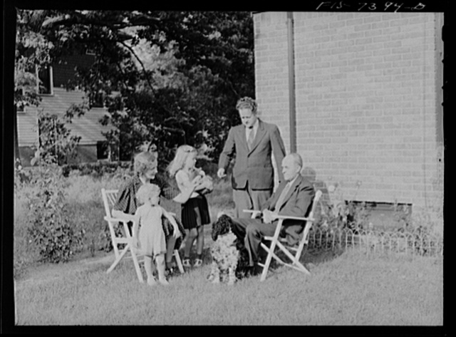 Dearborn, Michigan. Mrs. Peterson, daughter of Karl Axel Westerberg, and her two children, Joyce and Evelyn, with Eric Westerberg her brother outside the Peterson home