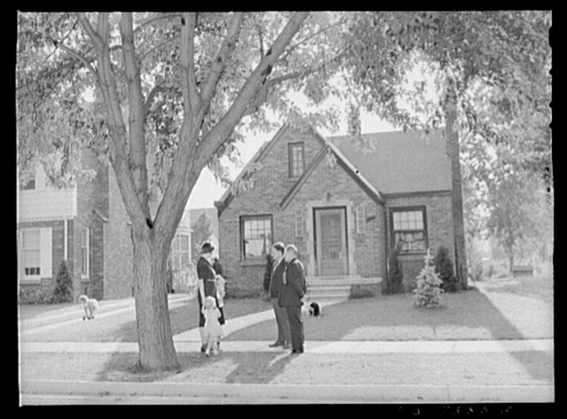 Dearborn, Michigan. Outside the pleasant brick home of Mrs. Ruth Peterson, the daugter of Karl Axel Westerberg. Her husband is employed as an expert tool and die maker at the Ford Motor Company. She and their two children are shown with her brother Eric and her father