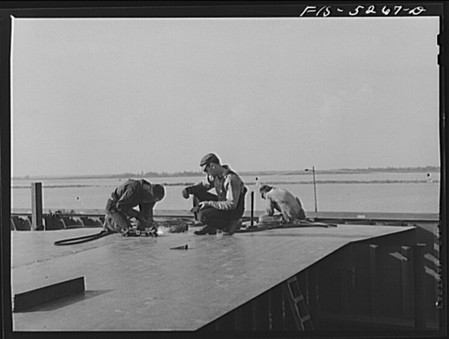 Decatur, Alabama. Ingalls Shipbuilding Company. Welding the deck of a cargo barge