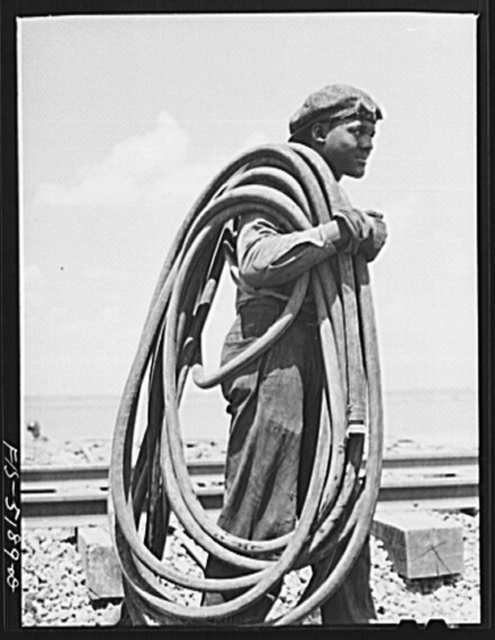 Decatur, Alabama. Ingalls Shipbuilding Company. Worker carrying air hose