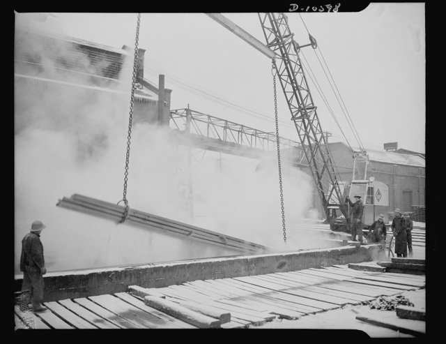 Denver, Colorado. Steel ship parts getting a bath of sulphuric acid at one of the eight Denver plants which prepares the parts and sends them to Mare Island for assembly