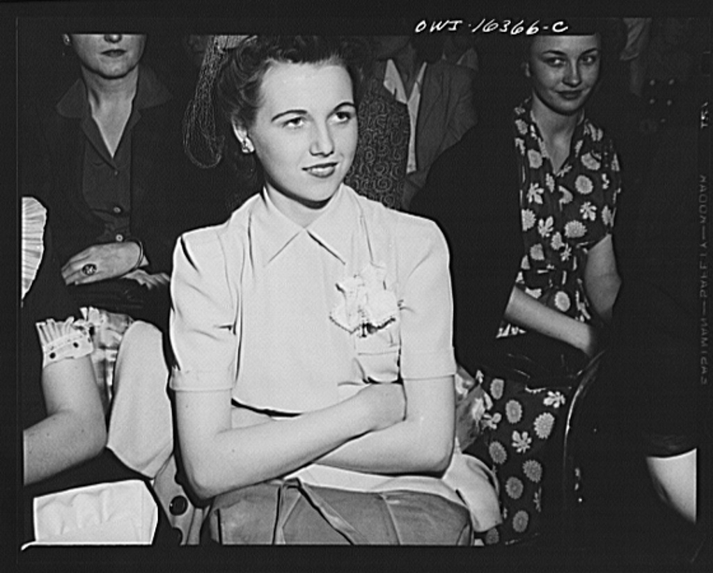 Detroit, Michigan. A Chrysler girl worker at Saks Fifth Avenue store following a fashion show presented by the Chrysler Girls' Club of the Chrysler Corporation