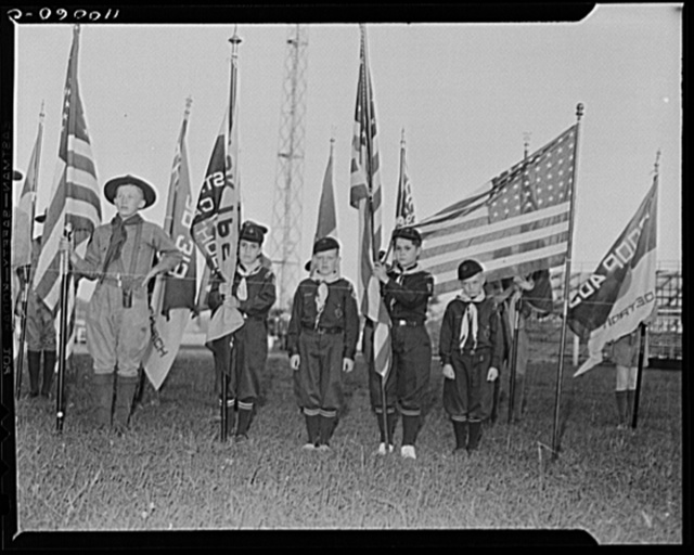 Detroit, Michigan. Cub Scouts with flag standards at the British Blitz Scout meeting