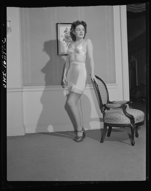 Detroit, Michigan. Fashion show presented by the Chrysler Girls' Club of the Chrysler Corporation at the Saks Fifth Avenue store. Girl modeling a brassiere and girdle