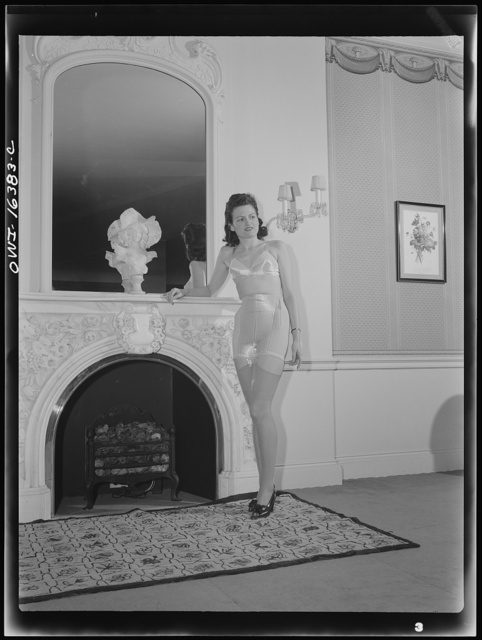 Detroit, Michigan. Fashion show presented by the Chrysler Girls' Club of the Chrysler Corporation at Saks Fifth Avenue store. Girl modeling brassiere and pantie girdle