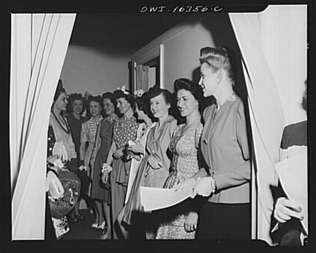 Detroit, Michigan. Fashion show presented by the Chrysler Girls' Club of the Chrysler Corporation at Saks Fifth Avenue store. Chrysler girls who are modeling clothes waiting for their turn to go on