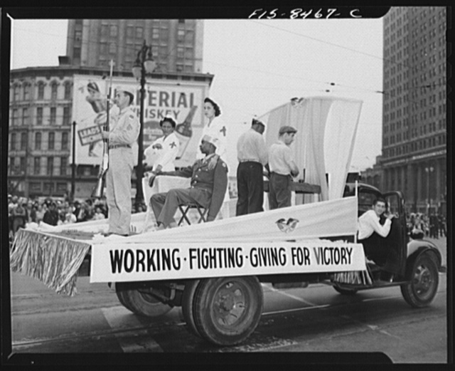 Detroit, Michigan. Float in the Labor Day parade showing relationship between the Army, Red Cross and industrial workers