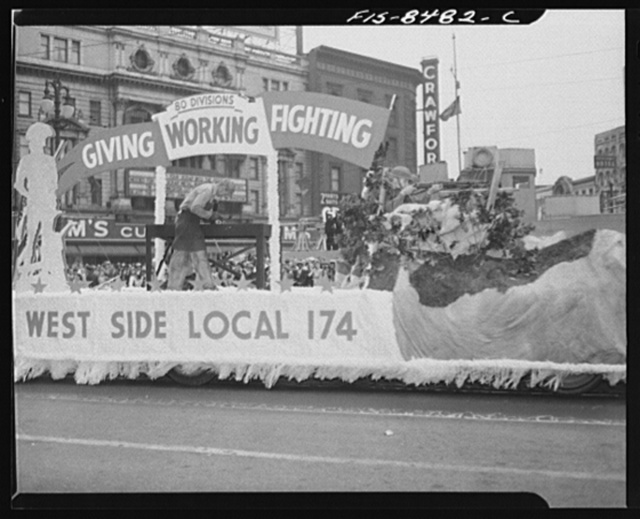 Detroit, Michigan. Float in the Labor Day parade showing soldiers and worker