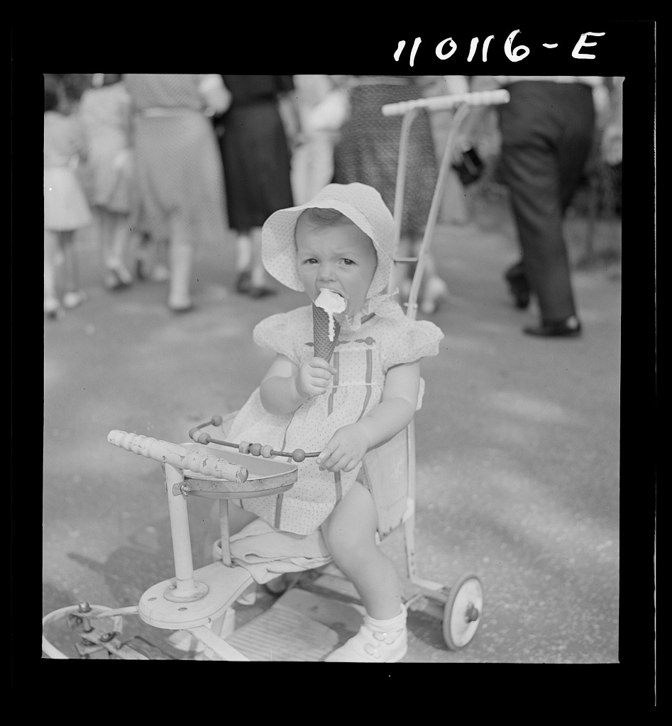 Detroit, Michigan. Little girl with ice cream cone in the zoological park