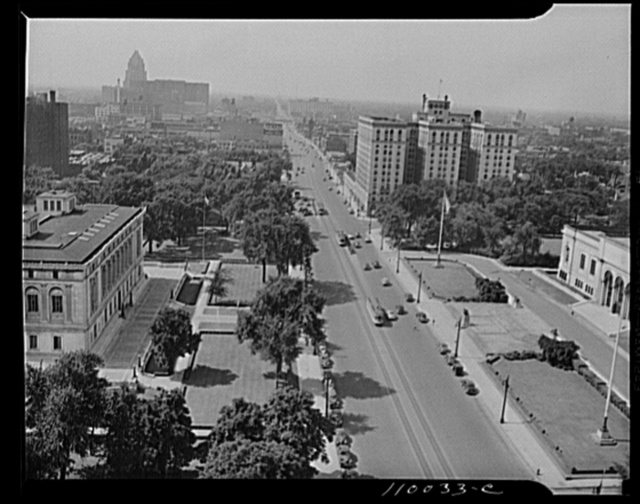 Detroit, Michigan. Looking north on Woodward Avenue from the Maccabee Building, with the Fisher Building at the far left and the Wardell hotel at the middle right