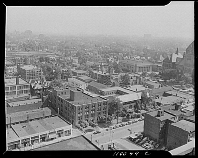 Detroit, Michigan. Looking southwest from the Maccabee Building at a typical transition area with the Ambassador Bridge in the background