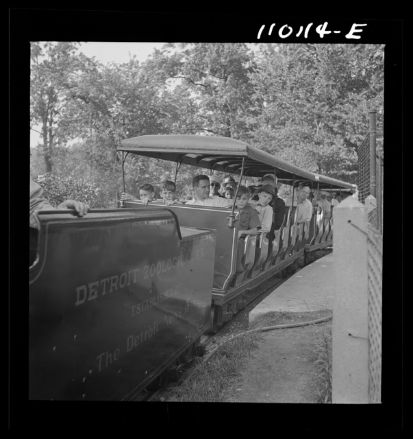 Detroit, Michigan. Narrow gauge train carrying people around the zoological park