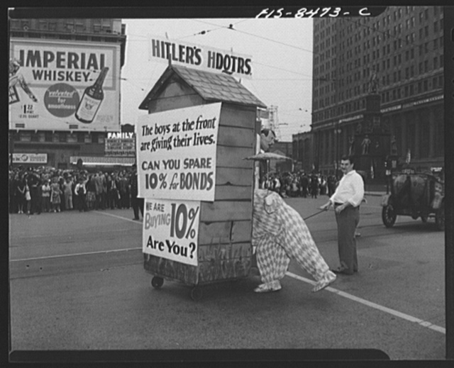 Detroit, Michigan. Outhouse and clown at Labor Day parade with plea for buying of war bonds