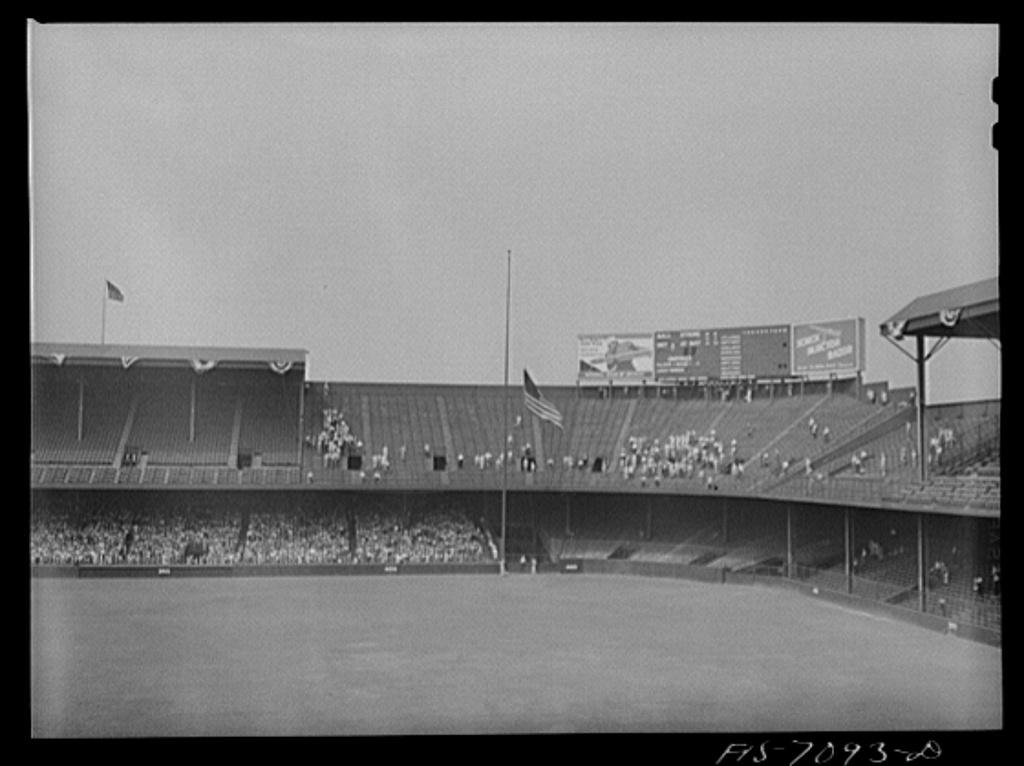 Detroit, Michigan. Raising the flag at the start of the ball game at Briggs Stadium