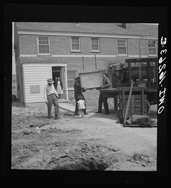 Detroit, Michigan. Riot at the Sojourner Truth homes, a new U.S. federal housing project, caused by white neighbors' attempt to prevent Negro tenants from moving in. First Negro family moving into Sojourner Truth homes