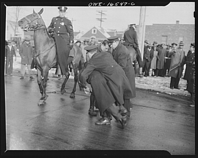 Detroit, Michigan. Riot at the Sojourner Truth homes, a new U.S. federal housing project, caused by white neighbors' attempt to prevent Negro tenants from moving in. Police arresting a Negro
