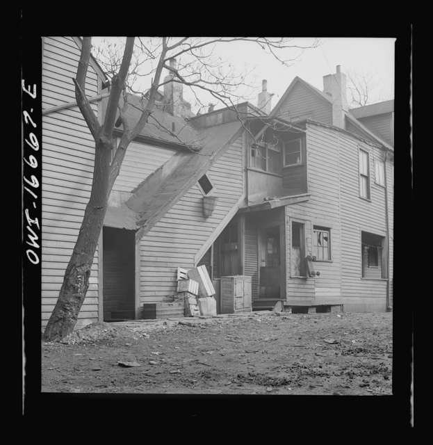 Detroit, Michigan. Seven Negro families live in this di lapidated house. These are conditions under which families originally lived before moving to the Sojourner Truth housing project