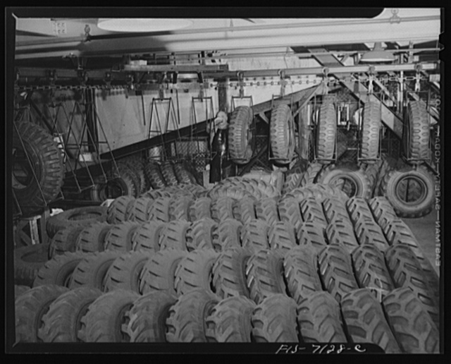 Detroit, Michigan (vicinity). Chrysler Corporation Dodge truck plant. Row upon row of rugged tires wait to be lifted on to conveyors which deposit them at the right spot on the steadily moving Dodge Army truck production line