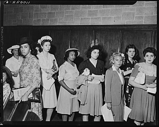 Detroit, Michigan. White and Negro youths line up to register for the salvage drive