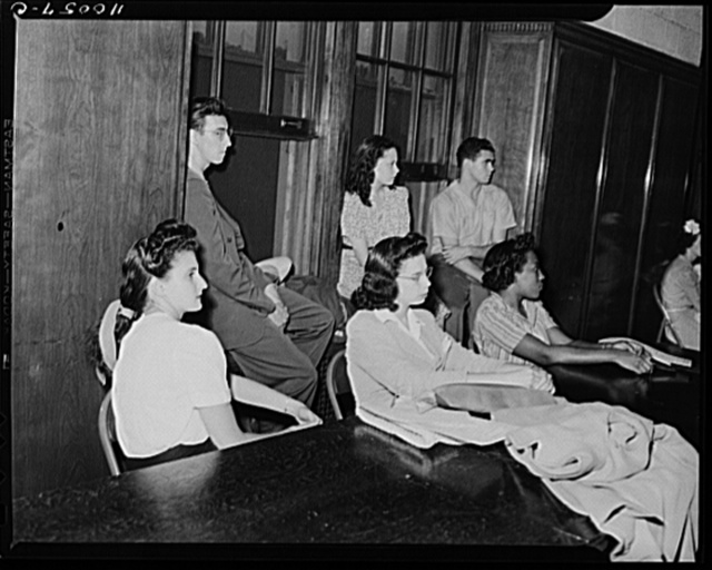 Detroit, Michigan. Youths listening to speakers at a salvage committe meeting