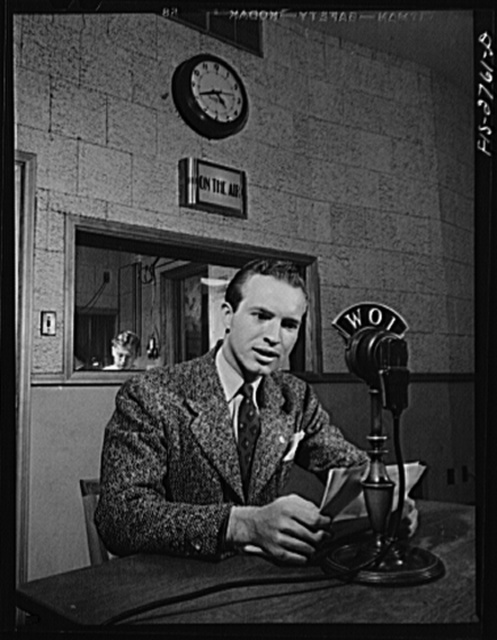 Don Jackson, a senior, delivering a news broadcast at the Iowa State College radio station. Jackson comes from a farm in Iowa. Recently won honorable mention in a nationwide contest sponsored by Dodd, Meade and Company for a book he wrote and which they published. He lost a brother in the Pearl Harbor attack. Jackson has worked his way through college. Iowa State College, Ames, Iowa