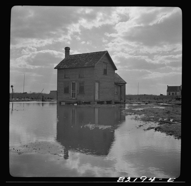 "Dorchester County, Maryland. High tide sweeps under the floor of this ""waterman's"" home on Gibson Island"