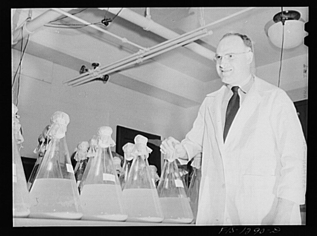Dr. Herrald R. Cox with flasks of typhus vaccine obtained from eggs according to the method which he developed. USPHS (United States Public Health Service)  Rocky Mountain Laboratory, Hamilton, Montana