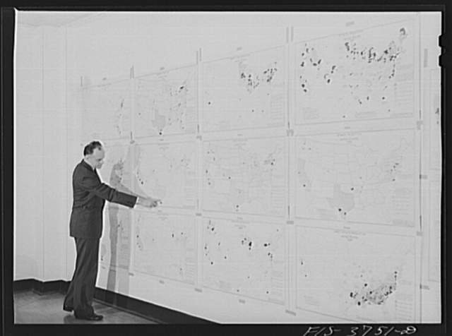 Dr. W. D. Ramage, chief industrial analyst, with agricultural charts developed by his division showing areas of relative production of various vegetables. Regional agricultural research division, Albany, Calif