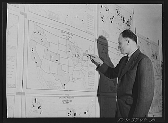 Dr. W.D. Ramage, senior industrial analyst, with agricultural charts. Regional agricultural research laboratory, Albany, California
