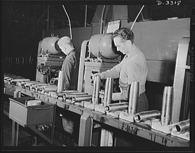 Each shell must have proper identification as it travels along the production line. This operation imposes no undue burden on the trained workers of a converted automobile plant where the shells are being made. Oldsmobile, Lansing, Michigan