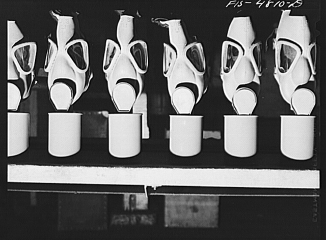 Edgewood Arsenal, Maryland. Gas demonstration. Gas masks reconditioned for civilian defense use at the gas mask factory