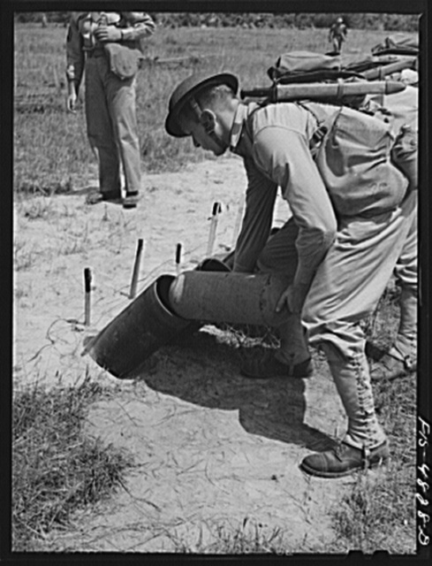 Edgewood Arsenal, Maryland. Gas demonstration. Loading a battery of Livens projectors with gas shells