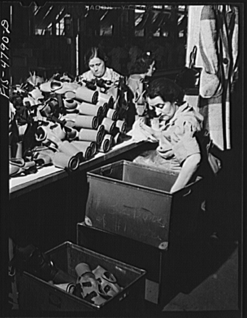 Edgewood Arsenal, Maryland. Gas demonstration. Reconditioning gas masks for civilian defense use at the gas mask factory