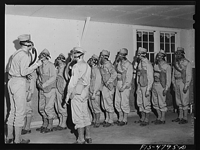 Edgewood Arsenal, Maryland. Gas demonstration. Soldiers in gas chamber filled with tear gas