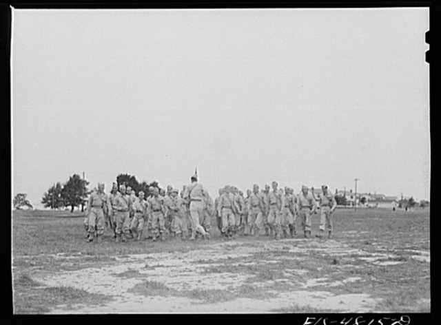 Edgewood Arsenal, Maryland. Gas demonstration. Soldiers running through a cloud of phosgene gas in order to learn its identity by odor