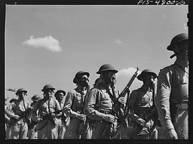 Edgewood Arsenal, Maryland. Gas demonstration. Soldiers wearing gas masks after having been sprayed with gas from a plane