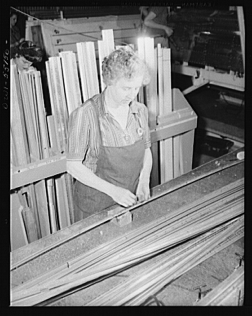 Elderly women as well as young women find work in the aircraft industry. This North American employee assembles stringers in the sheet metal sub-assembly department