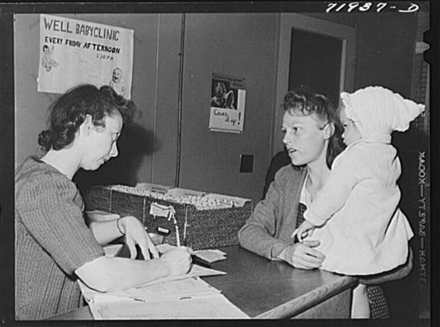 Eleven Mile Corner, Arizona. Cairns General Hospital, FSA (Farm Security Administration) farm workers' community. Registering at the clinic