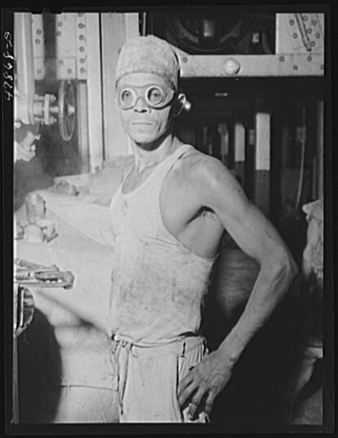 Ensenada, Puerto Rico. Laborer wearing goggles as protection against the fumes and vapors of hot molasses at the South Puerto Rico Sugar Company