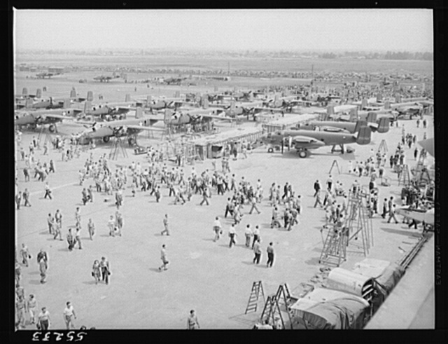 Every few months at North American, employees are given an opportunity to see the ships they build perform during their lunch period. Part of the thousands of employees are seen here going back to their work after seeing a thrilling performance by B-25 bombers and P-51 fighters