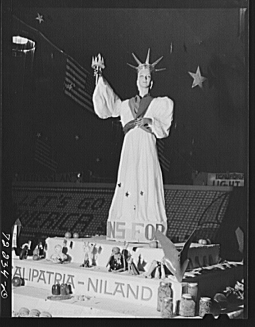 """Exhibit at the Imperial County Fair, California. The words at the base of statue are """"Vitamins for Victory."""" Notice the plowshares on corners of exhibit"""