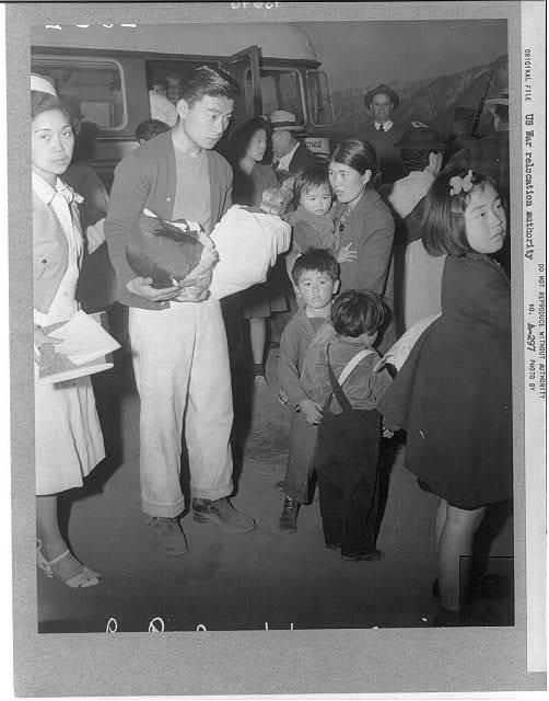 [Family upon arrival at Manzanar]
