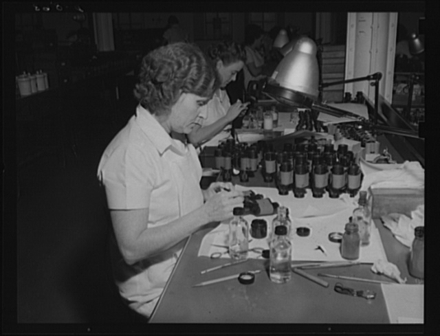 Far-sighted Army eyes. Assembly of standard field glasses for the Army at an eastern arsenal. Optical equipment is an important part of military requirements