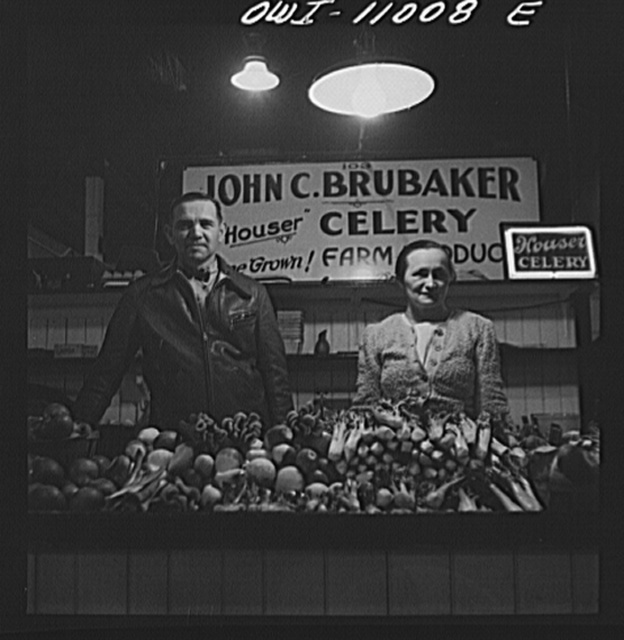 Farmer and his wife at her stall in Central Market. Lancaster, Pennsylvania