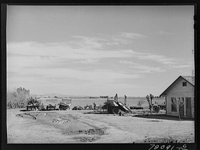 Farmyard, Imperial County, California. In Imperial County, comparatively few farm owners live on the farms, usually the houses seen on the farms are those of the foremen