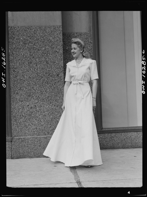 Fashion show presented by the Chrysler Girls' Club of the Chrysler Corporation at Saks Fifth Avenue store. Girl in a hostess gown