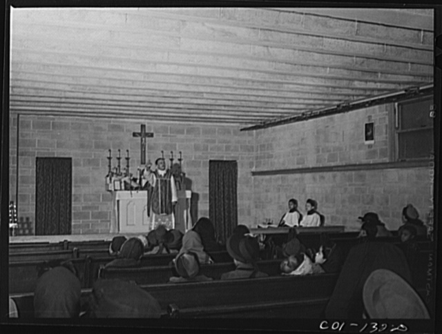 Father Smith, colored pastor, conducting Mass at a Negro Catholic church service on the South Side of Chicago, Illinois