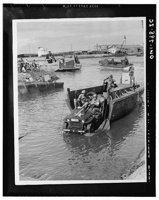 Fedala, Morocco. Jeep rolling off a landing boat at Fedala harbor during the landing operations of the U.S. task forces there